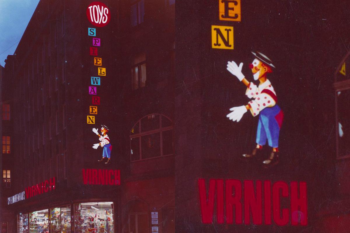 Schriftzug des Spielwarenhauses Virnich in Neon an der Fassade, ca. 1960er Jahre
